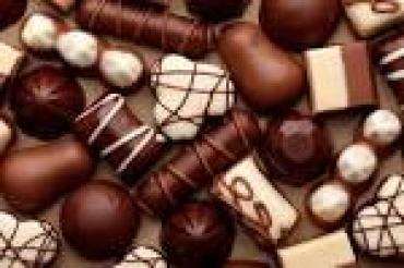 Specialty Chocolates May Contain Nuts.
